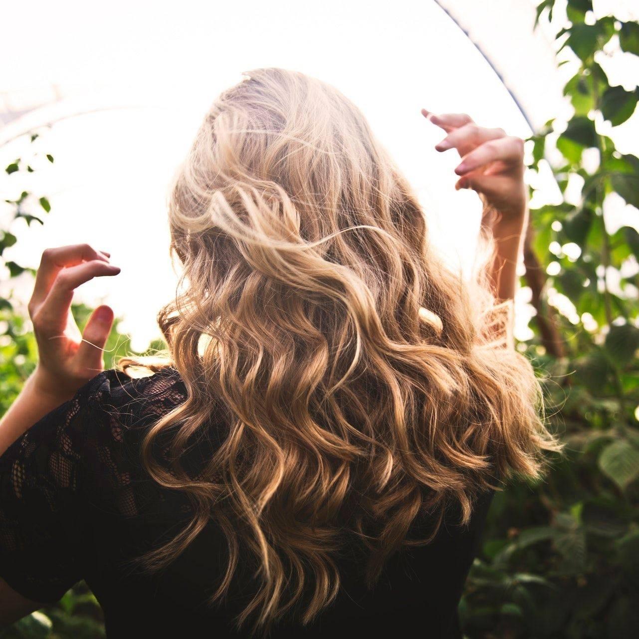 Hair Happenings logo